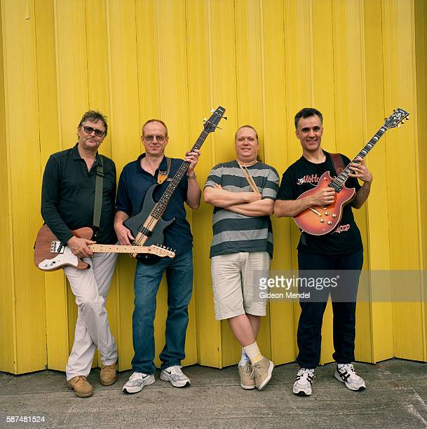 The members of the recently formed band 'Over the Hills' pose in front of a garage door on an industrial estate in Harlow close to the studio in...