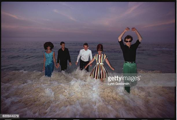 The members of the rock/new wave group the B52s stand knee deep in the ocean From left to right Cindy Wilson guitar and vocals Keith Strickland drums...