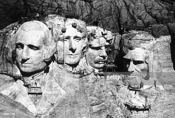 The memorial at Mount Rushmore South Dakota under construction The four heads are those of Presidents George Washington Thomas Jefferson Theodore...