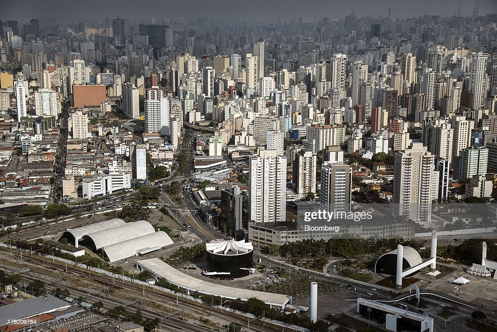The Memorial da America Latina, designed by architect Oscar Niemeyer, lower left, stands in this aerial photo taken in Sao Paulo, Brazil, on Friday, Aug. 23, 2013. Home sales in Sao Paulo, Brazils biggest real-estate market, rose 46 percent in January through June from a year earlier, while housing starts climbed 51 percent, according to Embraesp, a property research group, and Secovi, a real-estate agency association. Photographer: Paulo Fridman/Bloomberg via Getty Images