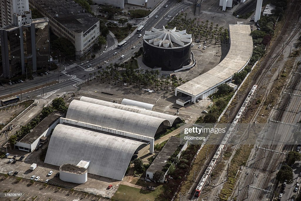 The Memorial da America Latina, designed by architect Oscar Niemeyer, stands in this aerial photo taken in Sao Paulo, Brazil, on Friday, Aug. 23, 2013. Home sales in Sao Paulo, Brazils biggest real-estate market, rose 46 percent in January through June from a year earlier, while housing starts climbed 51 percent, according to Embraesp, a property research group, and Secovi, a real-estate agency association. Photographer: Paulo Fridman/Bloomberg via Getty Images