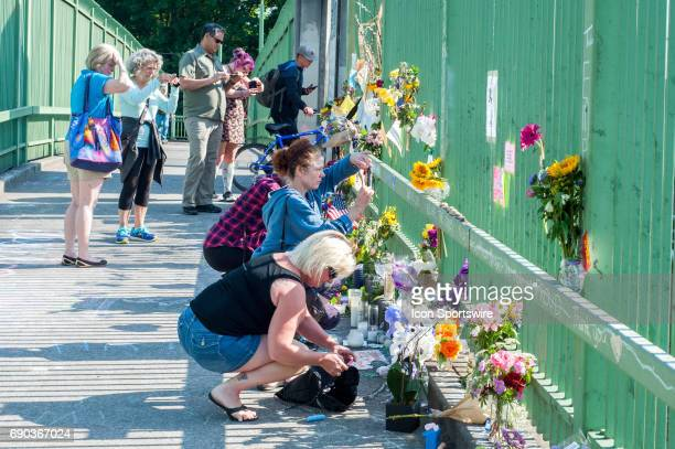 The memorial for the victims of the brutal stabbings at the Portland MAX light rail on Friday May 26 at Holliwood Transit Center Park and Ride