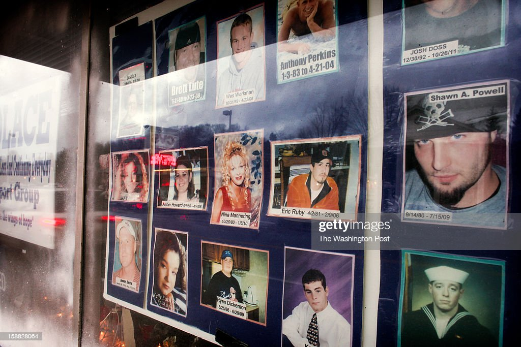 The memorial wall in the front window of SOLACE, an organization that seeks to end substance abuse in Ohio, remembers local victims of drug use and drug-related violence on Thursday, December 20, 2012 in Portsmouth, Ohio.