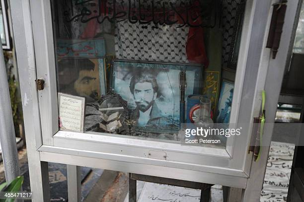 The memory box is full for one fallen soldier as Iranian believers and family members commemorate the dead martyrs of the 1980s IranIraq War on a...