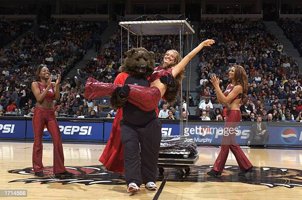 The Memphis Grizzlie's cheerleaders and mascot perform during half time of the game against the Orlando Magic at The Pyramid on December 27 2002 in...