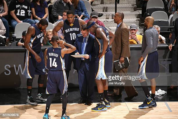 The Memphis Grizzlies huddle around David Joerger of the Memphis Grizzlies during the game against the San Antonio Spurs in Game Two of the Western...