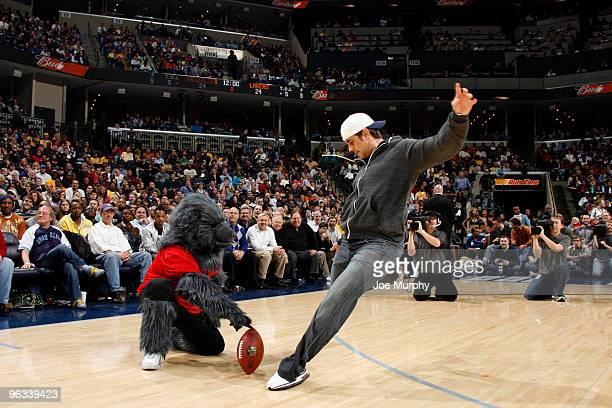 The Memphis Grizzlies mascot helps New England Patriots kicker Stephen Gostkowski kick a field goal on February 1 2010 at FedExForum in Memphis...