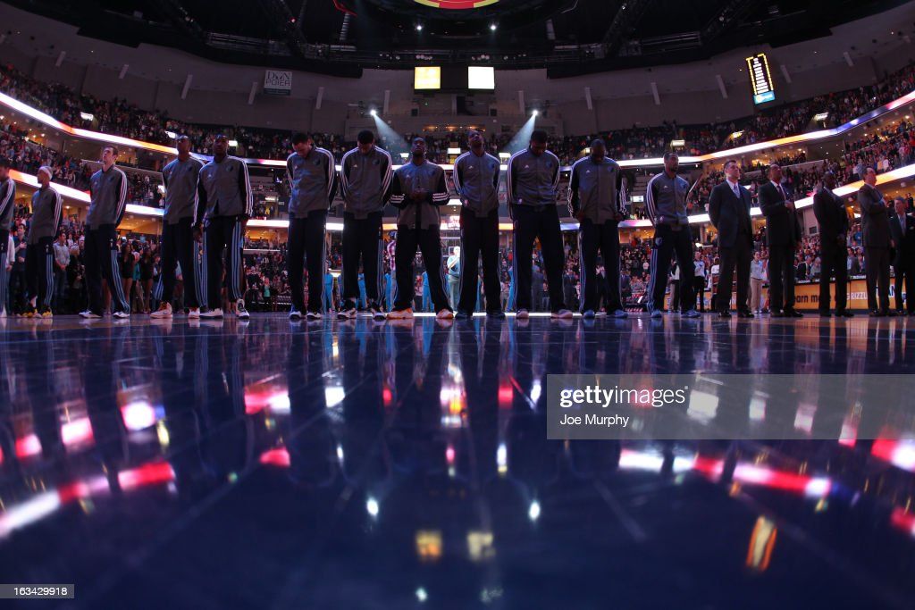 The Memphis Grizzlies observe the National Anthem before a game against the New Orleans Hornets on March 9, 2013 at FedExForum in Memphis, Tennessee.