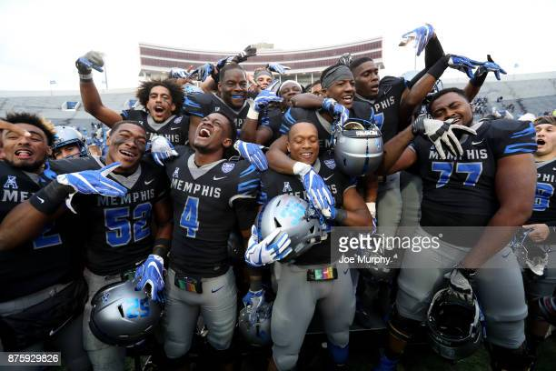 The Memphis Tigers celebrate after defeating the SMU Mustangs on November 18 2017 at Liberty Bowl Memorial Stadium in Memphis Tennessee Memphis...