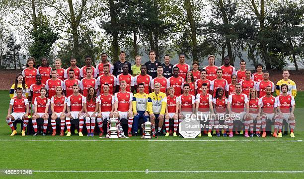 The Men and Ladies first team squads pose during the Arsenal Squad photo shoot 2014/15 at London Colney on September 11 2014 in St Albans England...