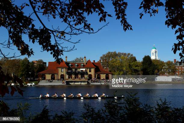 The Men's Alumni Eights team from MIT makes their way to the starting line past the Weld Boathouse during the Head of the Charles Regatta on October...