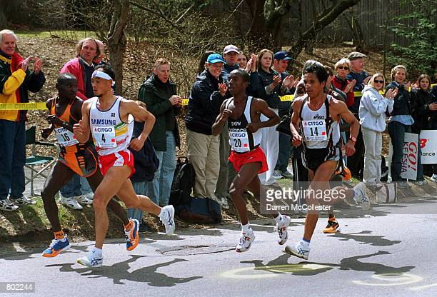 The men's lead pack crests Heartbreak Hill April 16th 2001 during the 105th Boston Marathon in Boston MA Korea's Lee BongJu pulled out the win The...