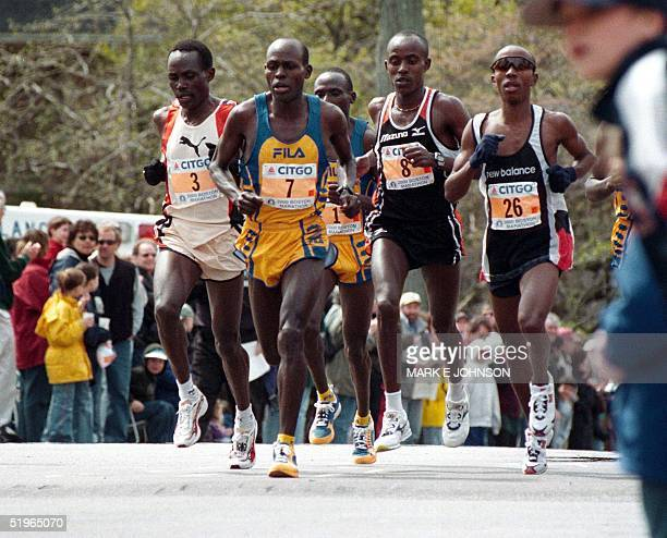 The men's lead pack crests the top of Heartbreak Hill in Newton Massachusetts during the 104th running of the Boston Marathon 17 April 2000 From left...