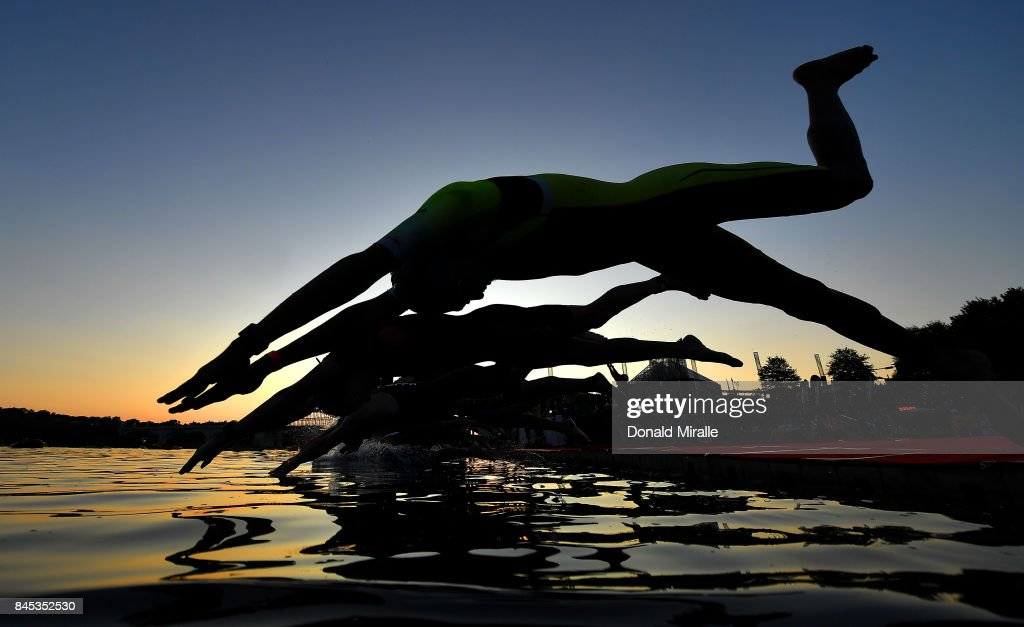 The men's professional triathletes start with the sunrise on the Tennessee River with John Ross Bridge in the background during the Men's IRONMAN 70.3 St. World Championships on September 10, 2017 in Chattanooga, Tennessee.