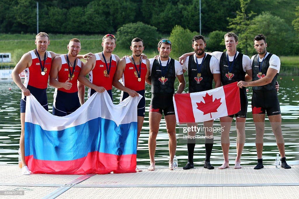 The Men's Quadruple Sculls teams of Russia (L) and Canada pose for a photo after qualifying for the 2016 Summer Olympic Games in Rio during Day 3 of the 2016 FISA European And Final Olympic Qualification Regatta at Rotsee on May 24, 2016 in Lucerne, Switzerland.