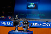 The Men's Singles and Women's Singles US Open trophies are seen during the draw ceremony prior to the start of the 2014 US Open at the USTA Billie...