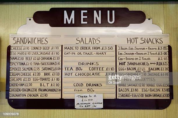 The menu board in Franks Sandwich Bar in West Kensington on February 21 2011 in London England The cafe has been run by three generations of the same...