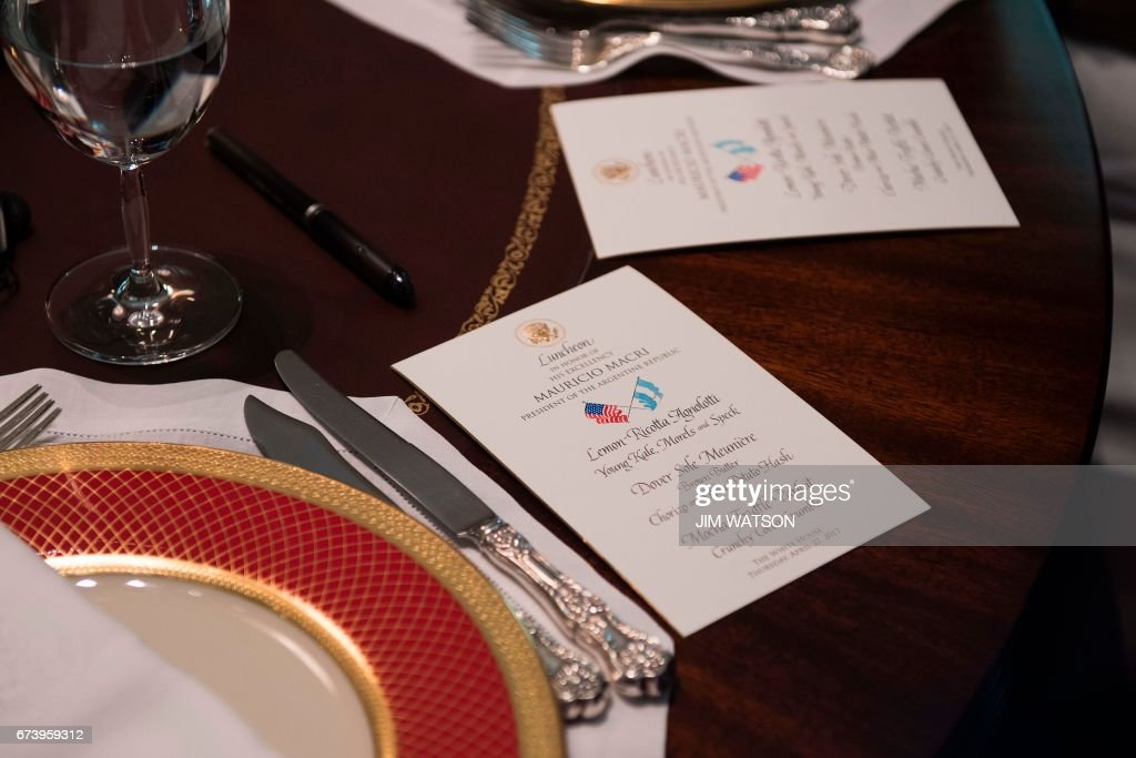 The menu rests on the table for the luncheon between US President Trump and Argentinian President Mauricio Macri at the White House in Washington, DC, April 27, 2017.
