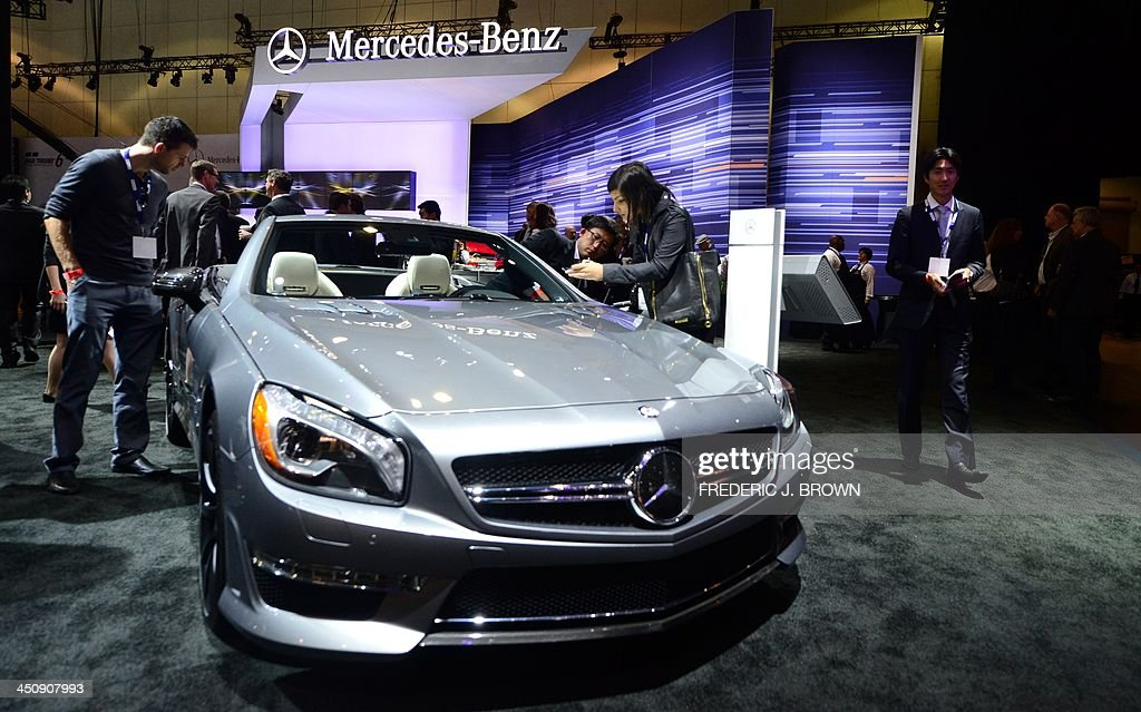 The Mercedes Benz SL65 convertible v12 BiTurbo attracts attention while displayed on November 20, 2013 during media previews at the LA Auto Show in Los Angeles, California. The LA Auto Show will be open to the public from November 22 to December 1. AFP PHOTO/Frederic J. BROWN