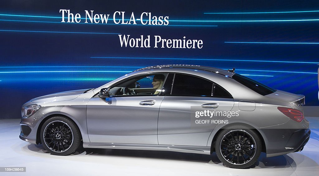 The Mercedes CLA class car is premiered at a press event on the eve of the 2013 North American International Auto Show in Detroit, Michigan, January 13, 2013. AFP PHOTO / Geoff ROBINS