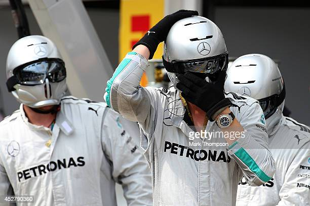 The Mercedes pit crew prepares for a pit stop during the Hungarian Formula One Grand Prix at Hungaroring on July 27 2014 in Budapest Hungary