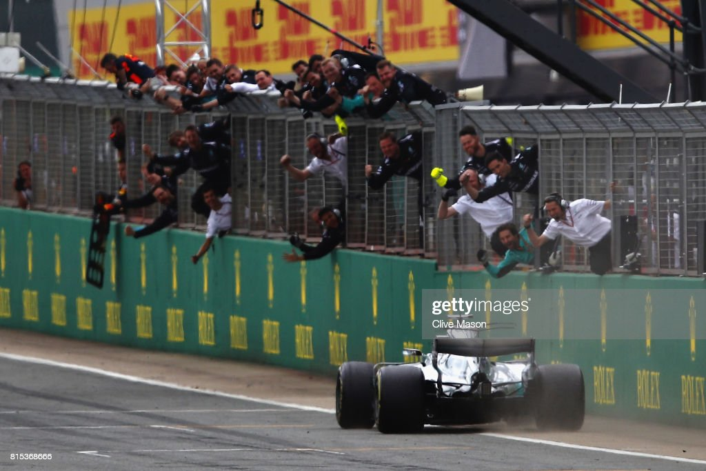 The Mercedes team celebrate the win of Lewis Hamilton of Great Britain driving the (44) Mercedes AMG Petronas F1 Team Mercedes F1 WO8 during the Formula One Grand Prix of Great Britain at Silverstone on July 16, 2017 in Northampton, England.