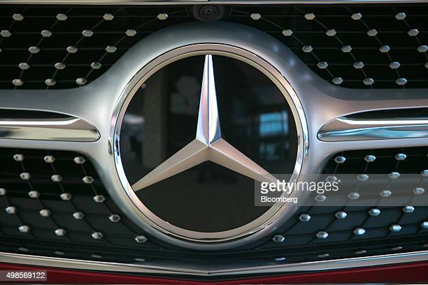 The MercedesBenz logo sits on a SClass automobile in the center of excellence showroom at Daimler AG's MercedesBenz factory in Sindelfingen Germany...