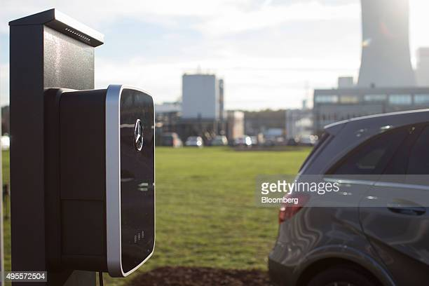 The MercedesBenz logo sits on an electric automobile charging station during a Daimler AG reusable battery storage event outside the headquarters of...