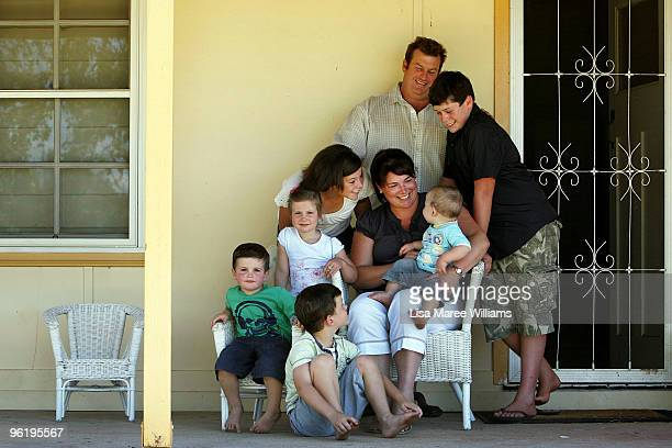 The Mercer family Heath Thomas Scarlett Madeleine Nicole Jed Matt and Patrick pose together at their country home called 'Barina' which is part of...