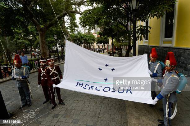 The Mercosur flag is raised in front of the Venezuelan Foreign Office building in Caracas on August 5 2016 The act ocurred after a meeting in...