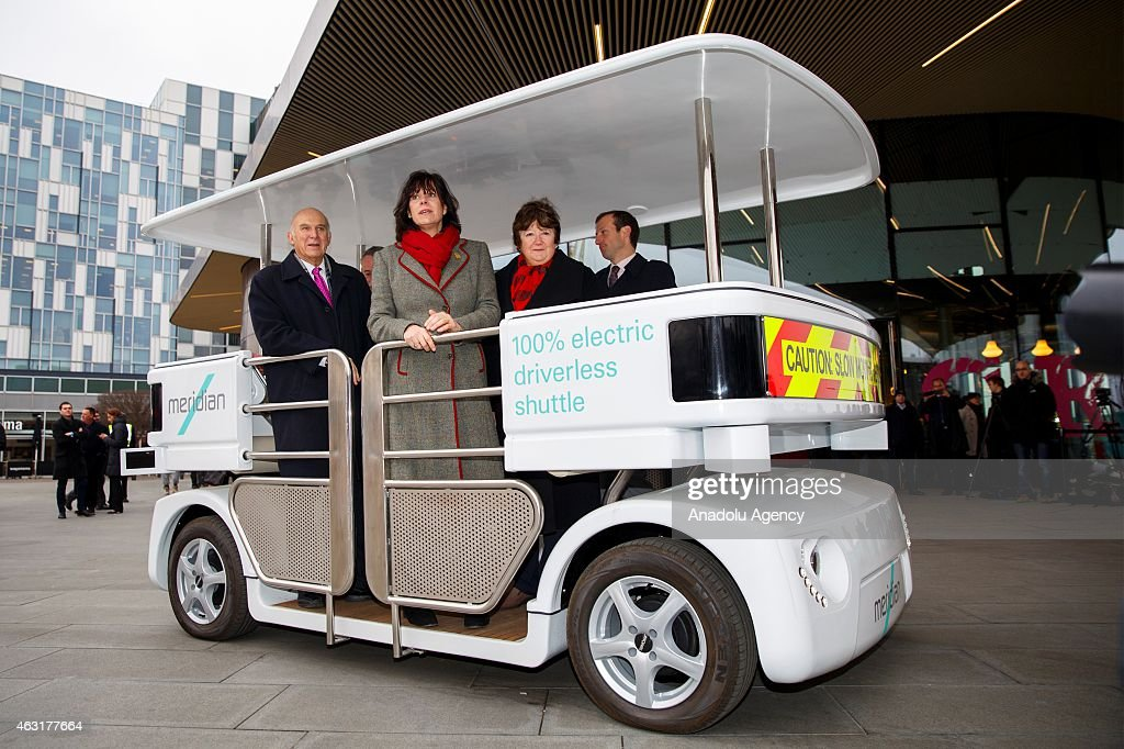 The Meridian shuttle, a driverless shuttle in fully autonomous mode carrying Transport Minister Claire Perry and Business Secretary <a gi-track='captionPersonalityLinkClicked' href=/galleries/search?phrase=Vince+Cable&family=editorial&specificpeople=4872939 ng-click='$event.stopPropagation()'>Vince Cable</a> at Peninsula Square in London, England on February 11, 2015. On Wednesday 11 February, Transport Minister Claire Perry and Business Secretary <a gi-track='captionPersonalityLinkClicked' href=/galleries/search?phrase=Vince+Cable&family=editorial&specificpeople=4872939 ng-click='$event.stopPropagation()'>Vince Cable</a> announce the outcome of a regulatory review undertaken to establish the framework to support the testing of driverless cars in the UK and officially launch three driverless car trials.