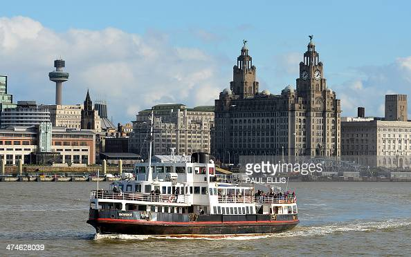 The Mersey Ferry boat 'Snowdrop' makes its way across the river from Liverpool arriving at Seacombe in north west England on February 24 2014 AFP...