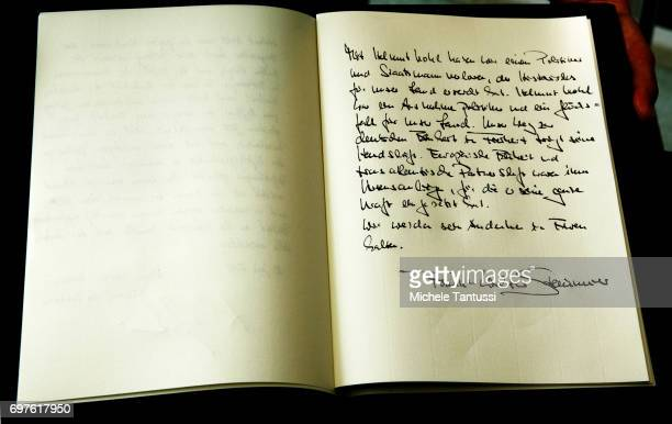 The message of German Federal President FrankWalter Steinmeier on the book of condolences next to a portrait of late former German Chancellor Helmut...