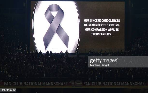 The message to commemorate the victims of Brussels terror attacks is displayed at a screen prior to the International Friendly match between Germany...
