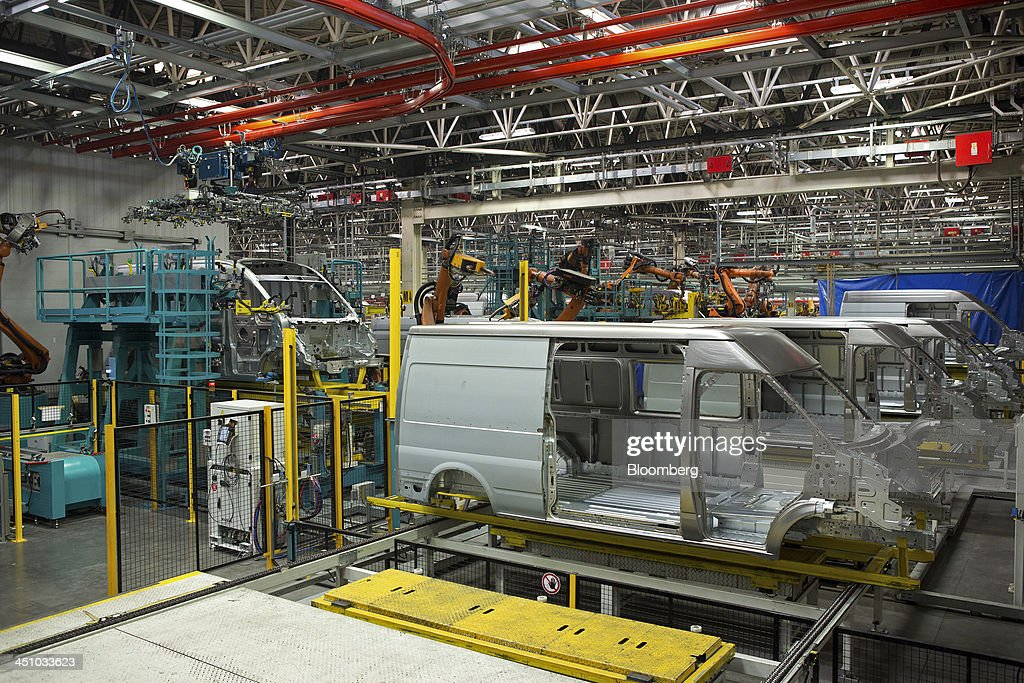 The metal shells of part complete Ford Transit vans travel along the semi-automated production line at the Ford Otosan plant, the joint venture between Ford Motor Co.'s Ford Otomotiv Sanayi AS and Koc Holding AS, in Golcuk, Turkey, on Wednesday, Nov. 20, 2013. Istanbul-based Automobile Distributors' Association, or ODD, forecasts Turkey's total automotive industry market to be between 830k and 870k this year. Photographer: Kerem Uzel/Bloomberg via Getty Images