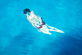 Metamorphosis of the man in turquoise waters of the Adriatic sea in Croatia, Europe.