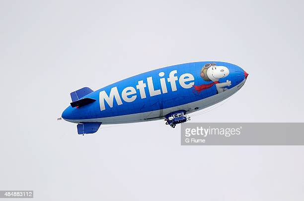 The MetLife blimp flies over the course during the first round of the Quicken Loans National at the Robert Trent Jones Golf Club on July 30 2015 in...