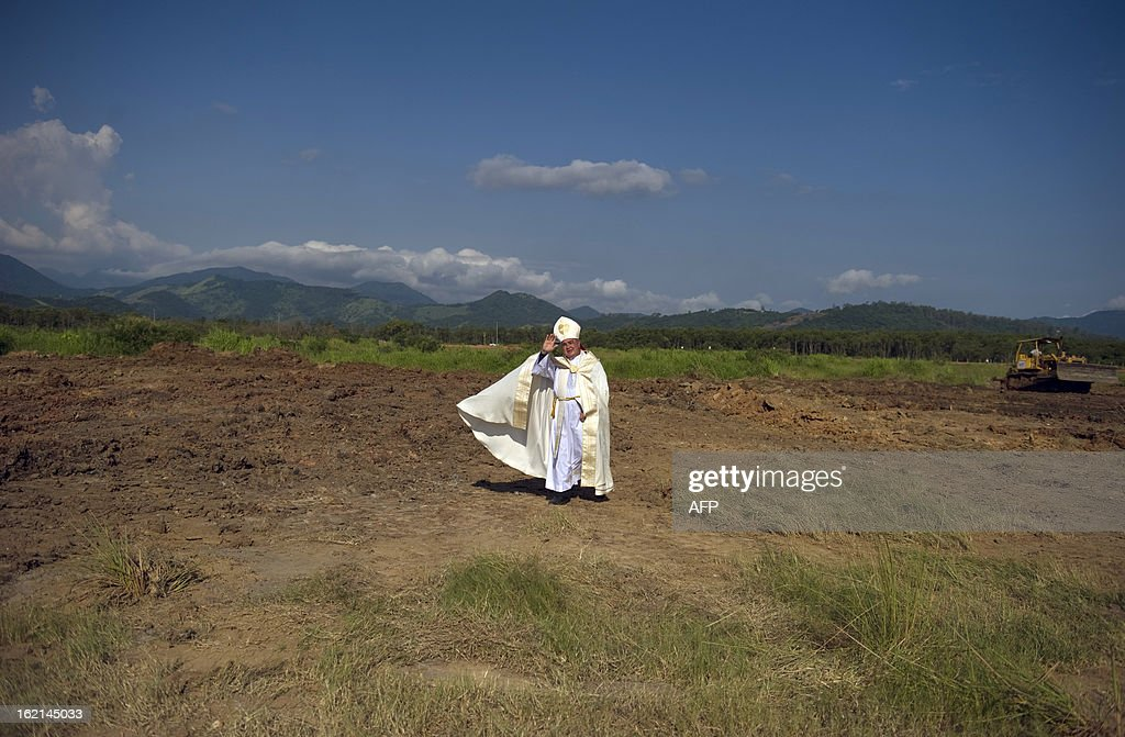 The Metropolitan Archbishop of Rio de Janeiro, Dom Orani Tempesta, blesses the place where the Pope is to celebrate mass during the July 27 and 28 visit and in the framework of the World Youth Day, in a farm in Guaratiba, western Rio de Janeiro, on February 19, 2013. According to official sources, about three million people are expected to attend the event.