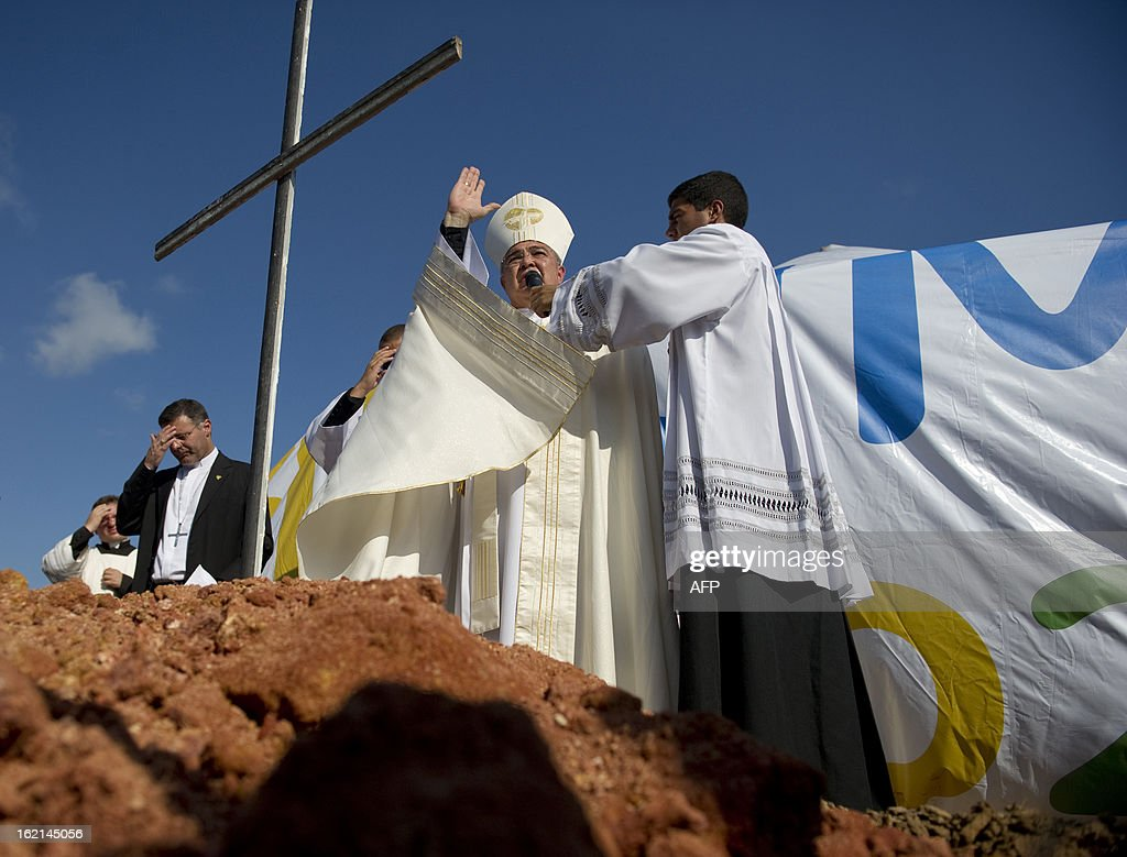 The Metropolitan Archbishop of Rio de Janeiro, Dom Orani Tempesta, blesses the place where an altar is to be constructed for the Pope to celebrate mass during the July 27 and 28 visit and in the framework of the World Youth Day, in a farm in Guaratiba, western Rio de Janeiro, on February 19, 2013. According to official sources, about three million people are expected to attend the event. AFP PHOTO/VANDERLEI ALMEIDA