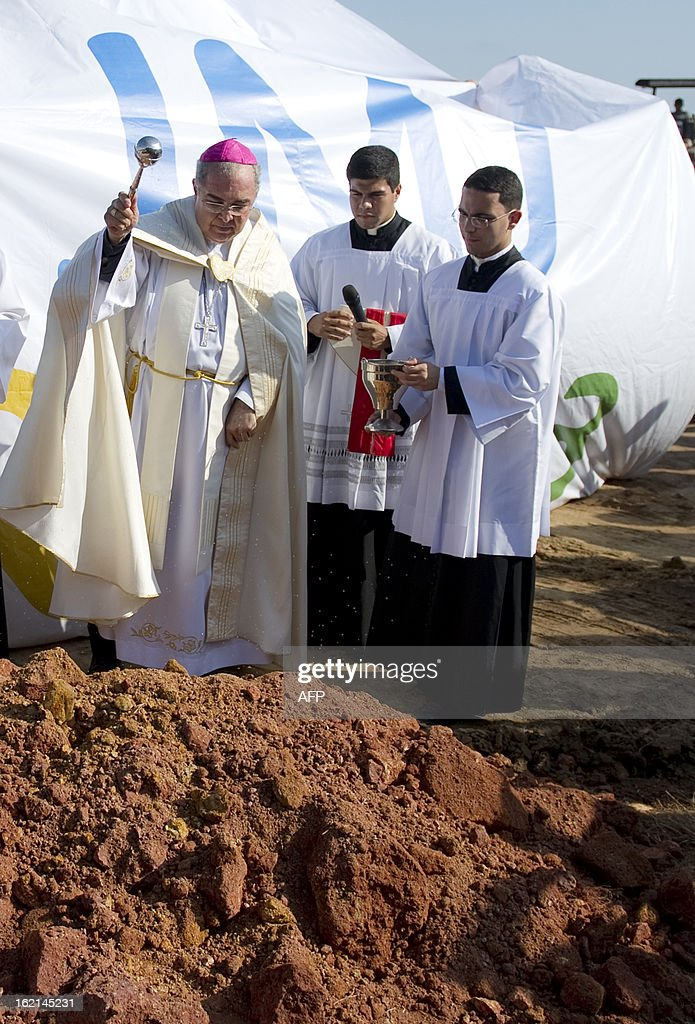 The Metropolitan Archbishop of Rio de Janeiro, Dom Orani Tempesta (L), blesses the place where an altar is to be constructed for the Pope to celebrate mass during the July 27 and 28 visit and in the framework of the World Youth Day, in a farm in Guaratiba, western Rio de Janeiro, on February 19, 2013. According to official sources, about three million people are expected to attend the event. AFP PHOTO/VANDERLEI ALMEIDA
