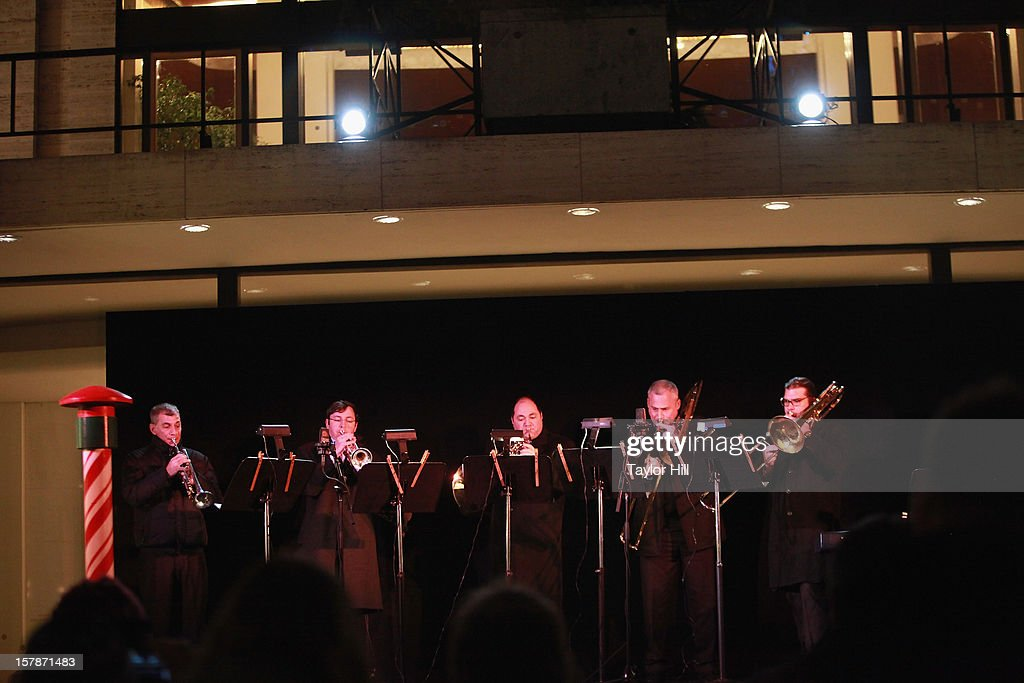The Metropolitan Opera Brass performs during The Metropolitan Opera Tree Lighting Ceremony at The Metropolitan Opera House on December 6, 2012 in New York City.