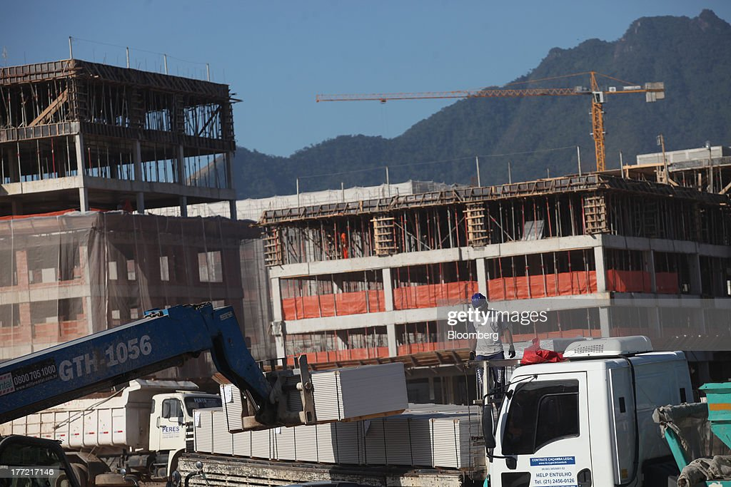 The Metropolitano Barra Shopping center stands under construction in Rio de Janeiro, Brazil, on Wednesday, Aug. 21, 2013. Latin America's largest economy created 7,154 manufacturing jobs and 4,899 construction jobs in July, down from 24,718 and 25,433 new posts a year ago. Photographer: Dado Galdieri/Bloomberg via Getty Images