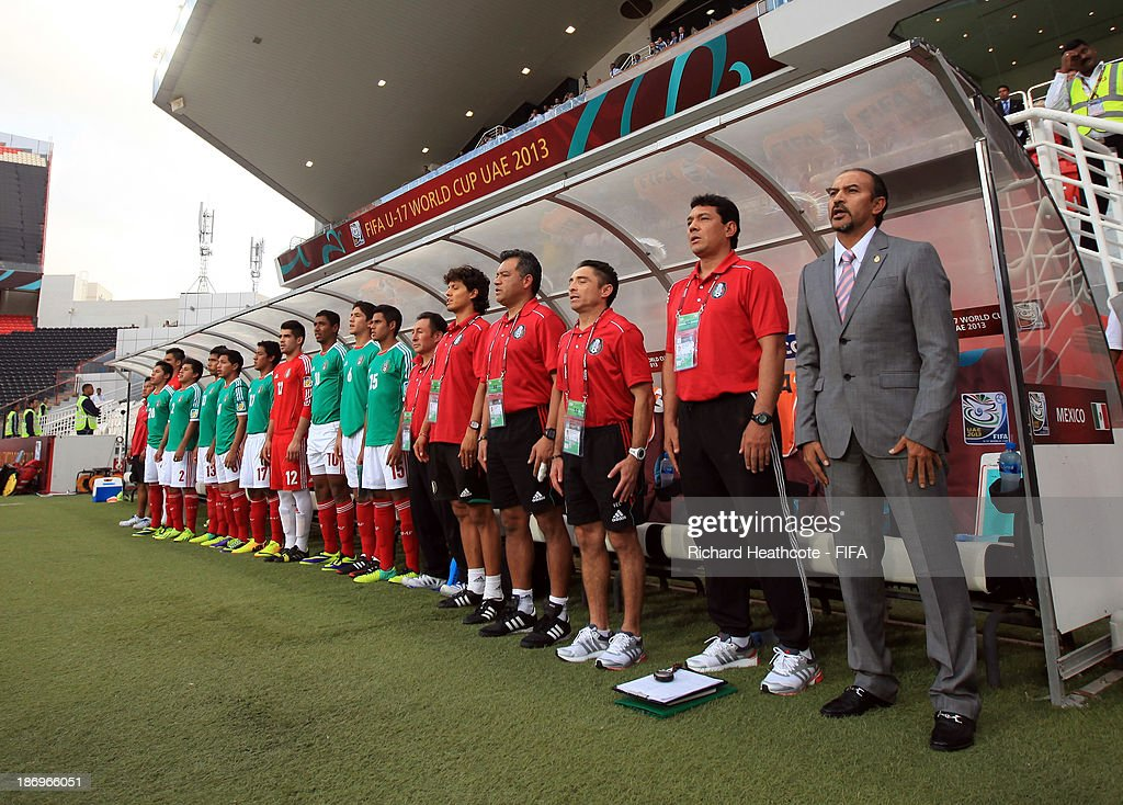 The Mexican bench sing the national anthem during the FIFA U-17 World Cup UAE 2013 Semi Final match between Argentina and Mexico at the Mohamed Bin Zayed Stadium on November 5, 2013 in Abu Dhabi, United Arab Emirates.