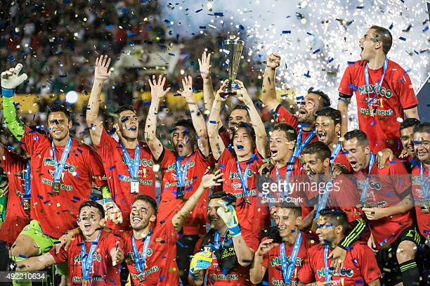 The Mexican National Team celebrates winning the CONCACAF Cup between the United States and Mexico at the Rose Bowl on October 10 2015 in Pasadena...