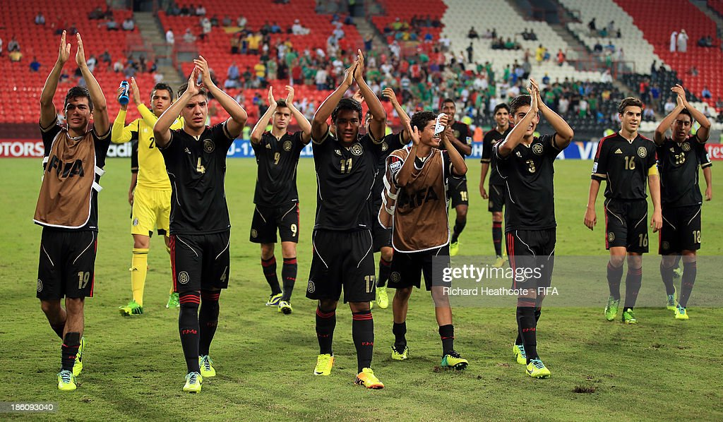 The Mexican team celebrate victory during the FIFA U-17 World Cup UAE 2013 Round of 16 match between Italy and Mexico at the Mohamed Bin Zayed Stadium on October 28, 2013 in Abu Dhabi, United Arab Emirates.