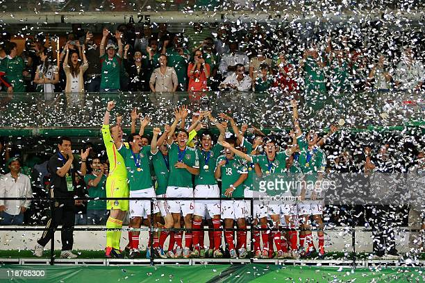 The Mexican team celebrate winning the U17 World Cup during the FIFA U17 World Cup Mexico 2011 Final match between Uruguay and Mexico at the Azteca...