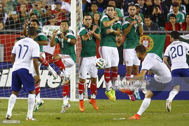The Mexico squad defends against a kick by Portugal's Miguel Veloso during an international friendly soccer match at Gillette Stadium June 6 in...
