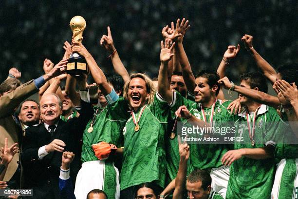 the Mexico team celebrate with the FIFA Confederations Cup trophy after beating Brazil in the final