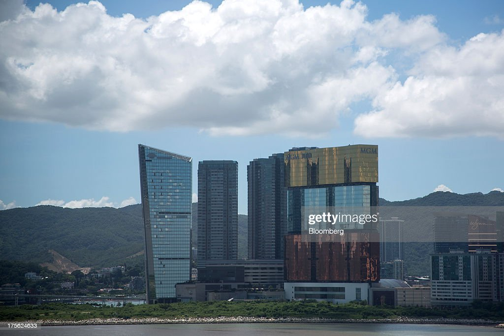 The MGM Macau, operated by MGM China Holdings Ltd., center right, stands in Macau, China, on Sunday, Aug. 4, 2013. MGM China Holdings is scheduled to release second quarter results on Aug. 6. Photographer: Lam Yik Fei/Bloomberg via Getty Images