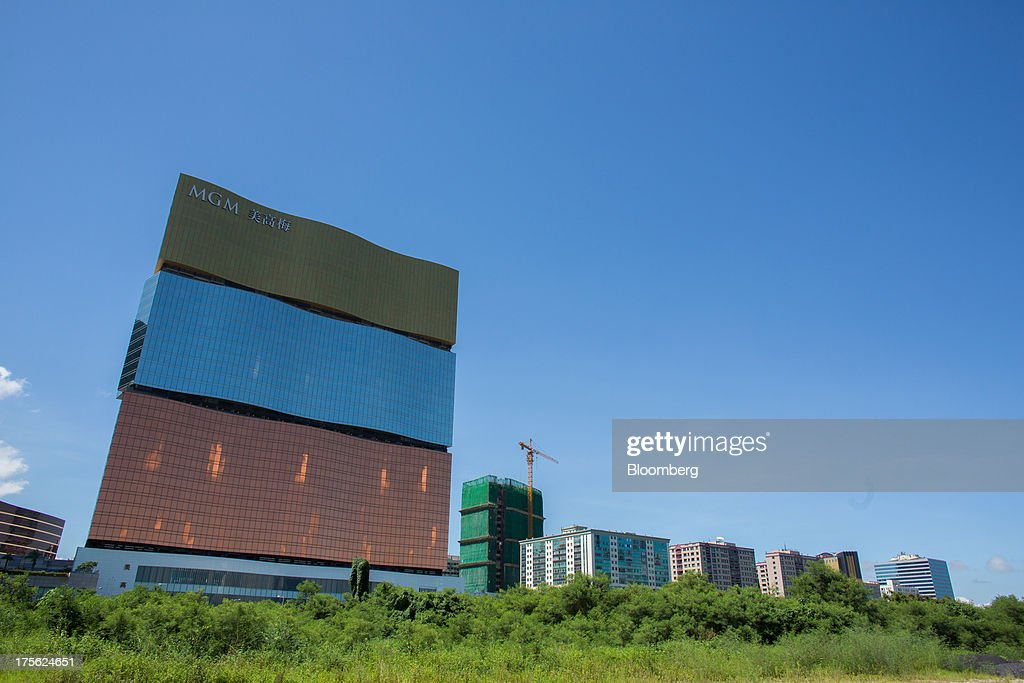 The MGM Macau, operated by MGM China Holdings Ltd., left, stands in Macau, China, on Sunday, Aug. 4, 2013. MGM China Holdings is scheduled to release second quarter results on Aug. 6. Photographer: Lam Yik Fei/Bloomberg via Getty Images